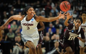 UConn women's basketball forward Morgan Tuck fights for a loose ball during a regional semifinal game of the 2016 NCAA women's tournament game against Mississippi State at Webster Bank Arena in Bridgeport, Connecticut. Photo by Bailey Wright